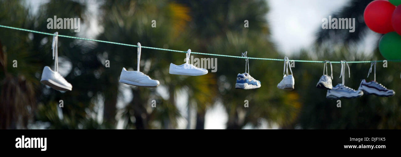 Dec 02, 2007 - West Palm Beach, Florida, USA - A collection of shoes and sneakers were hung across Flagler Drive at Curry Park by the Monopoly themed wacky water station team.  (Credit Image: © Cydney Scott/Palm Beach Post/ZUMA Press) RESTRICTIONS: * USA Tabloids Rights OUT * - Stock Image