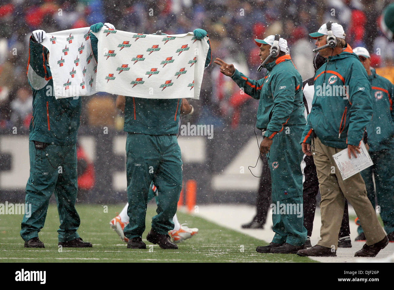 Dec 09, 2007 - Buffalo, New York, USA - Dolphins assistants hold up towels as defensive signals are called from Stock Photo