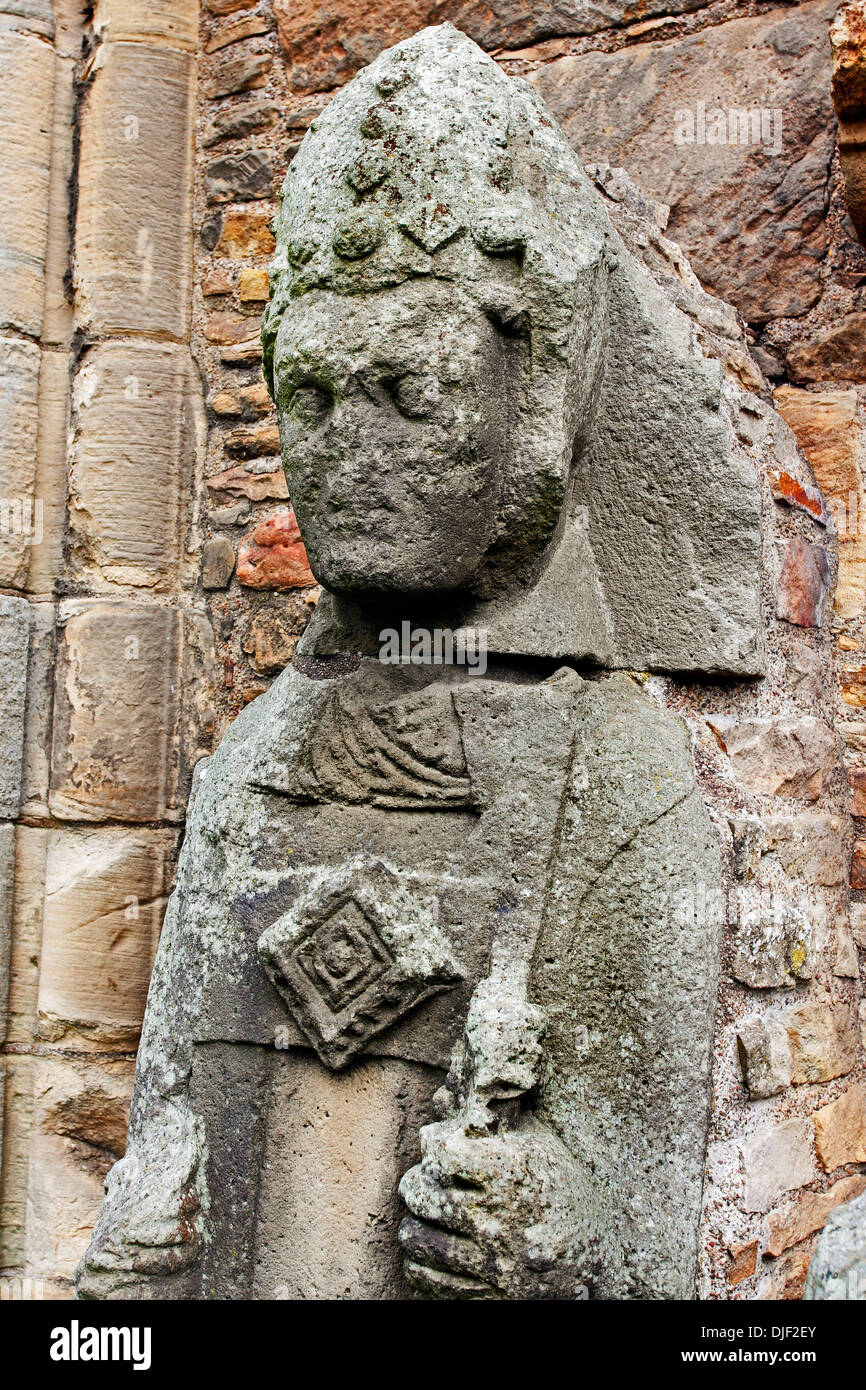 The stone figure of an historic Bishop of Elgin within the ruins of the medieval Cathedral walls. Stock Photo