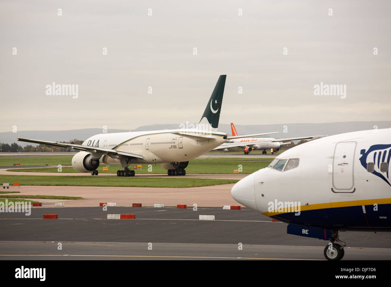 A Pakistan airlienes plane taxiing towards the runway at Manchester Airport, UK. - Stock Image