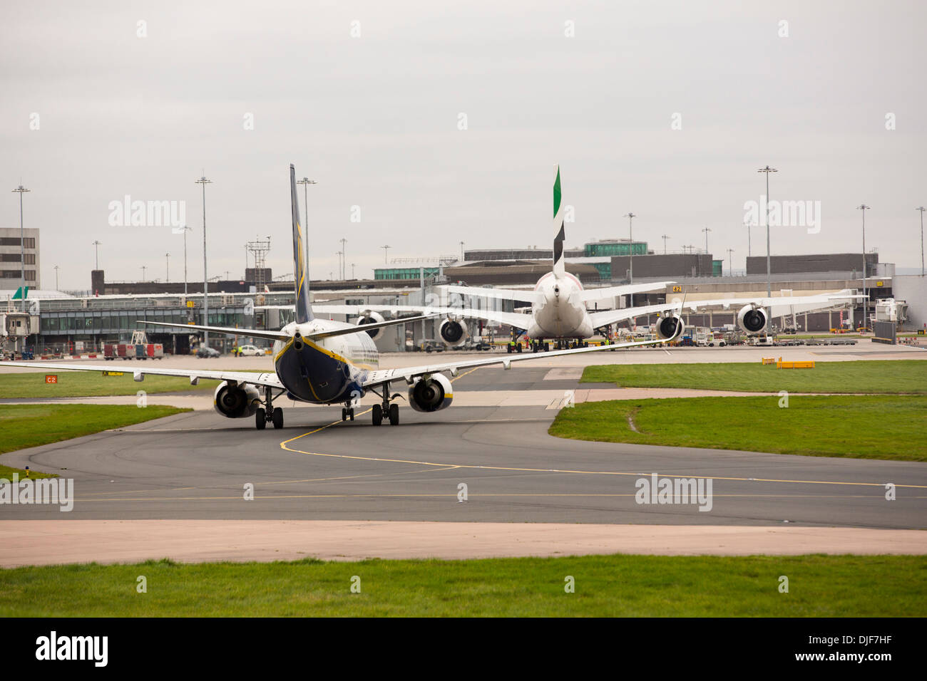 Planes taxiing towards arrivals at Manchester Airport, UK. - Stock Image