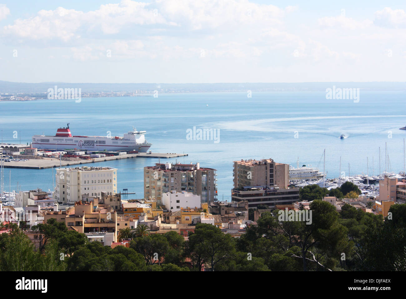 Buildings and seascape with a ferry in Majorca, Spain Stock Photo