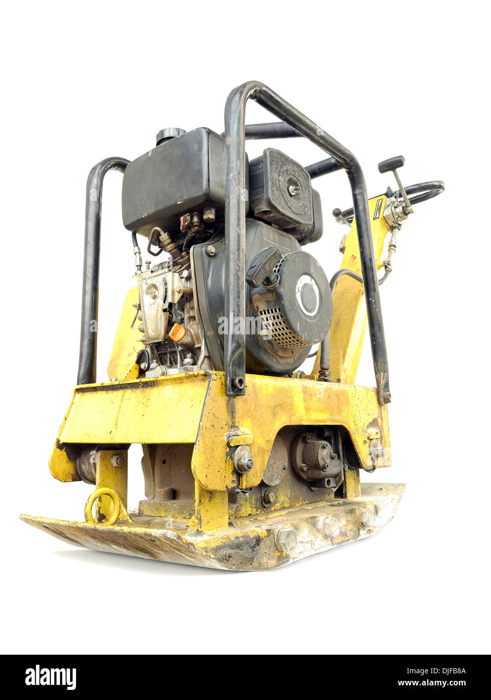 Old yellow plate compactor isolated on white - Stock Image