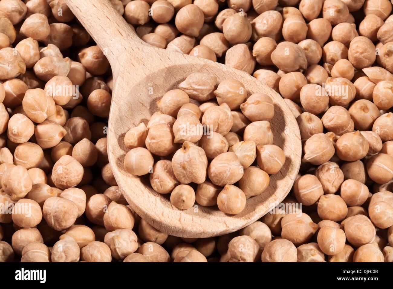 peas seeds closeup spoon wooden - Stock Image