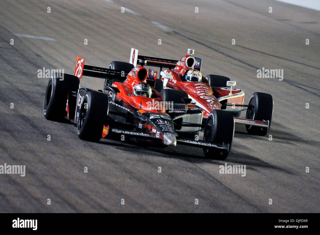 Marco Andretti (26) and Scott Dixon (9) face off at the Firestone ...