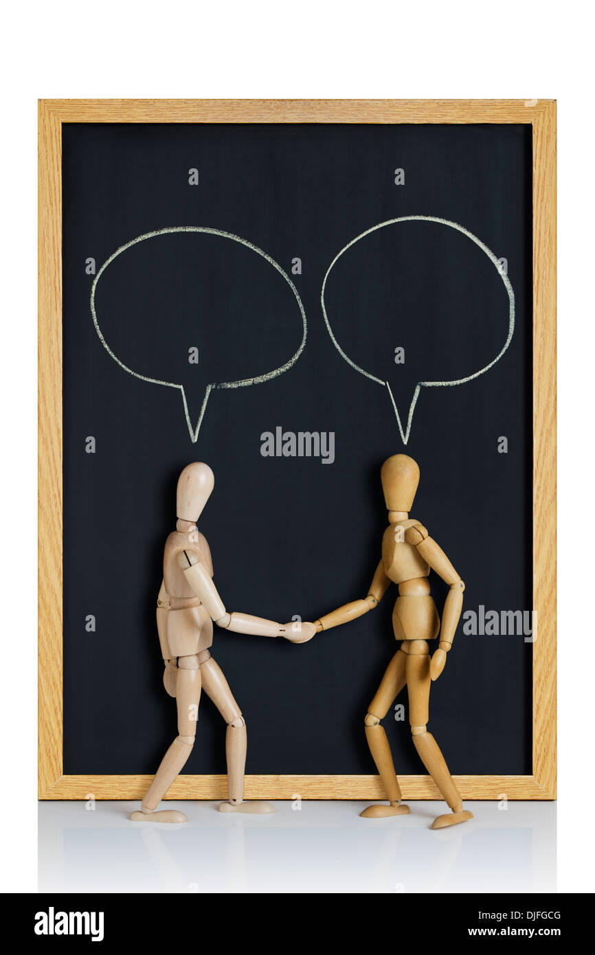 Meet and Greet. Manikins, anatomical models, placed on a chalkboard with cartoon talking balloons drawn on it. - Stock Image