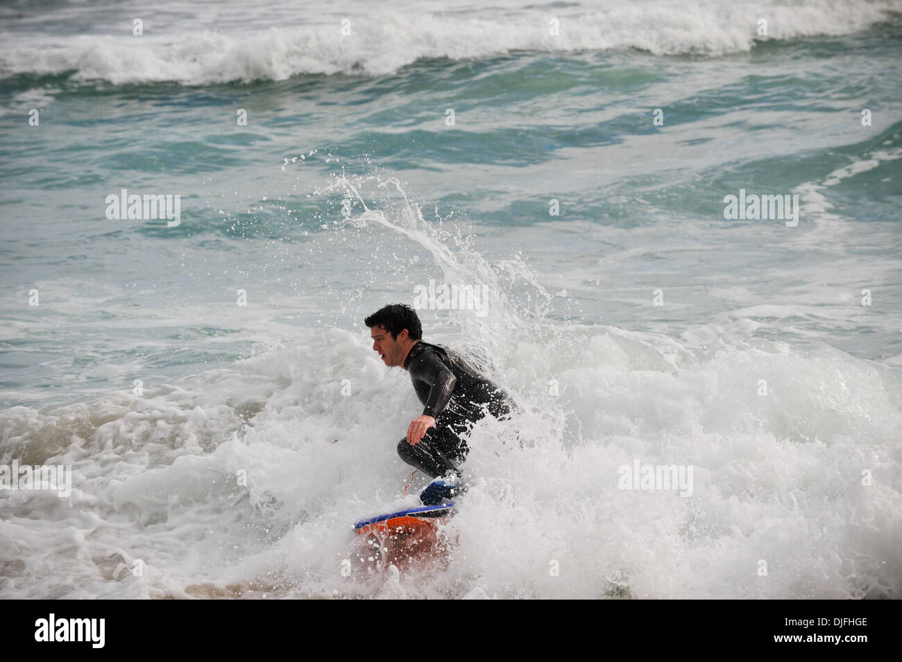 June 13, 2010 - Cape Town, SOUTH AFRICA - A body boarder rides the waves in the Camps Bay suburb of Cape Town Sunday, June 13, 2010 in South Africa. (Credit Image: © Mark Sobhani/ZUMApress.com) Stock Photo