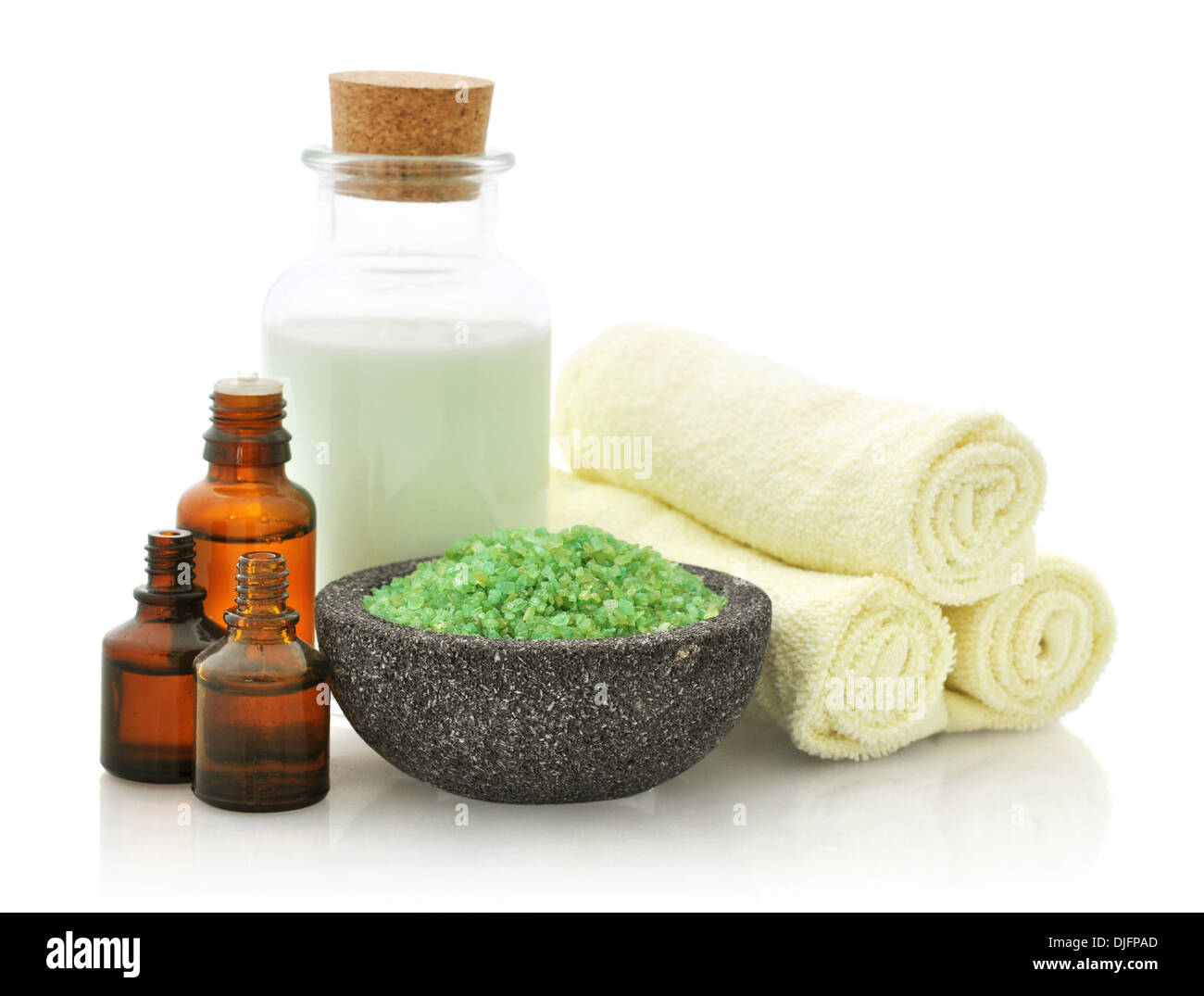 Spa composition with towels and sea salt isolated on white background - Stock Image
