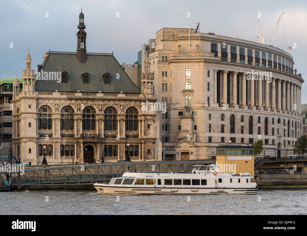 A Thames River Cruise passes by Unilever House and City of London School - Stock Image