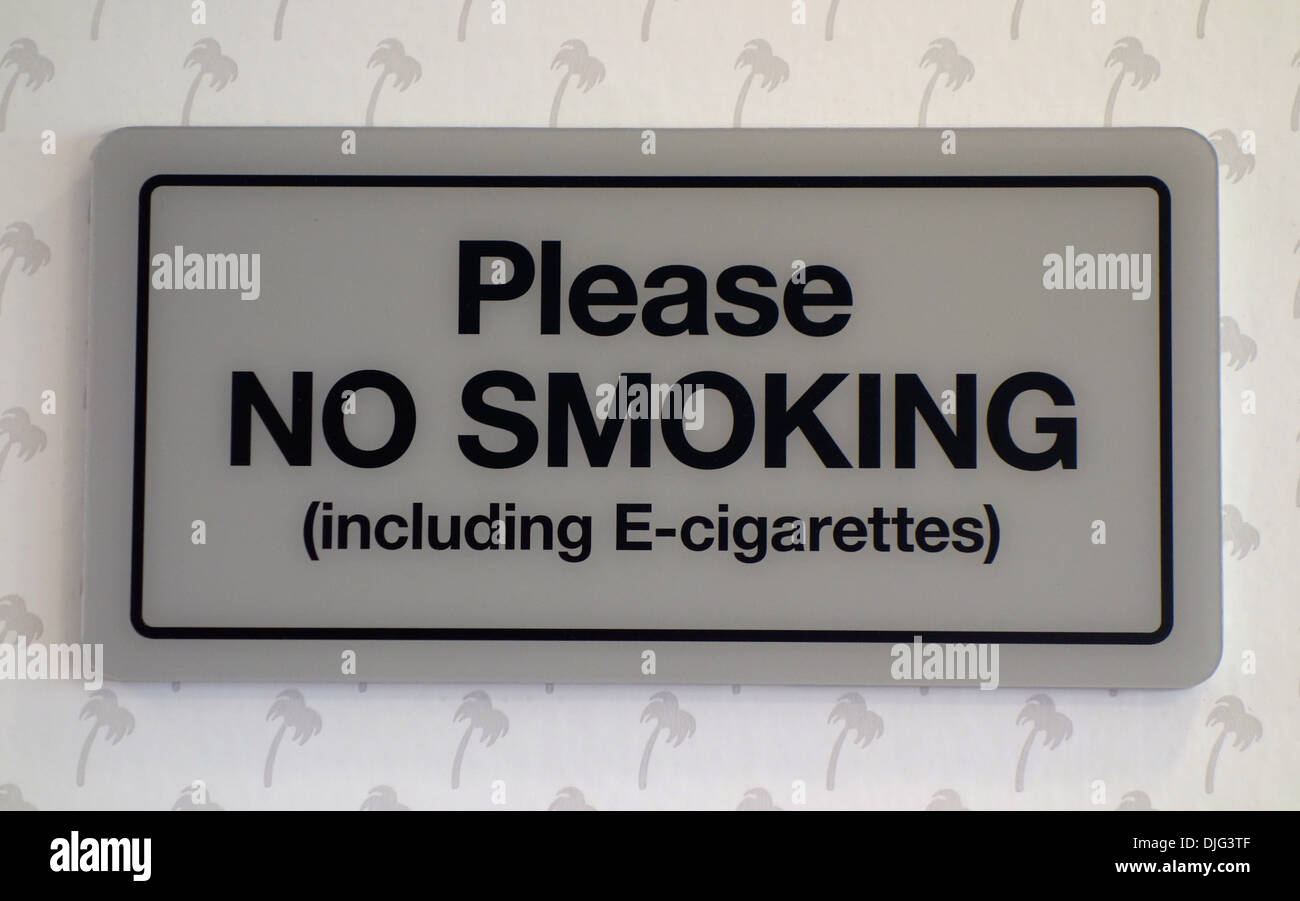 A sign in a restaurant states no smoking E-cigarettes. - Stock Image
