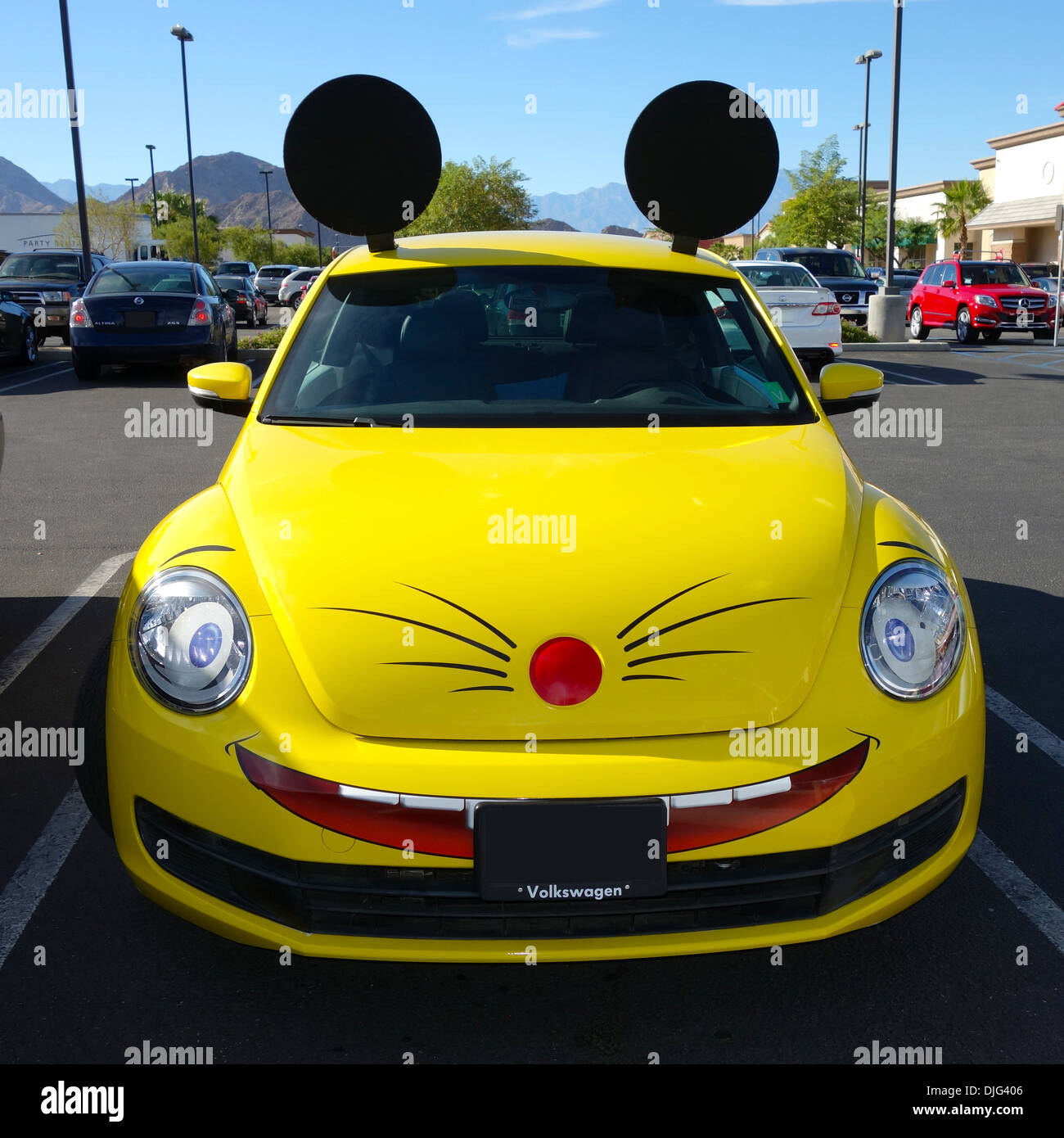 An extermination company based in La Quinta, California USA has their company car decorated like a mouse. - Stock Image