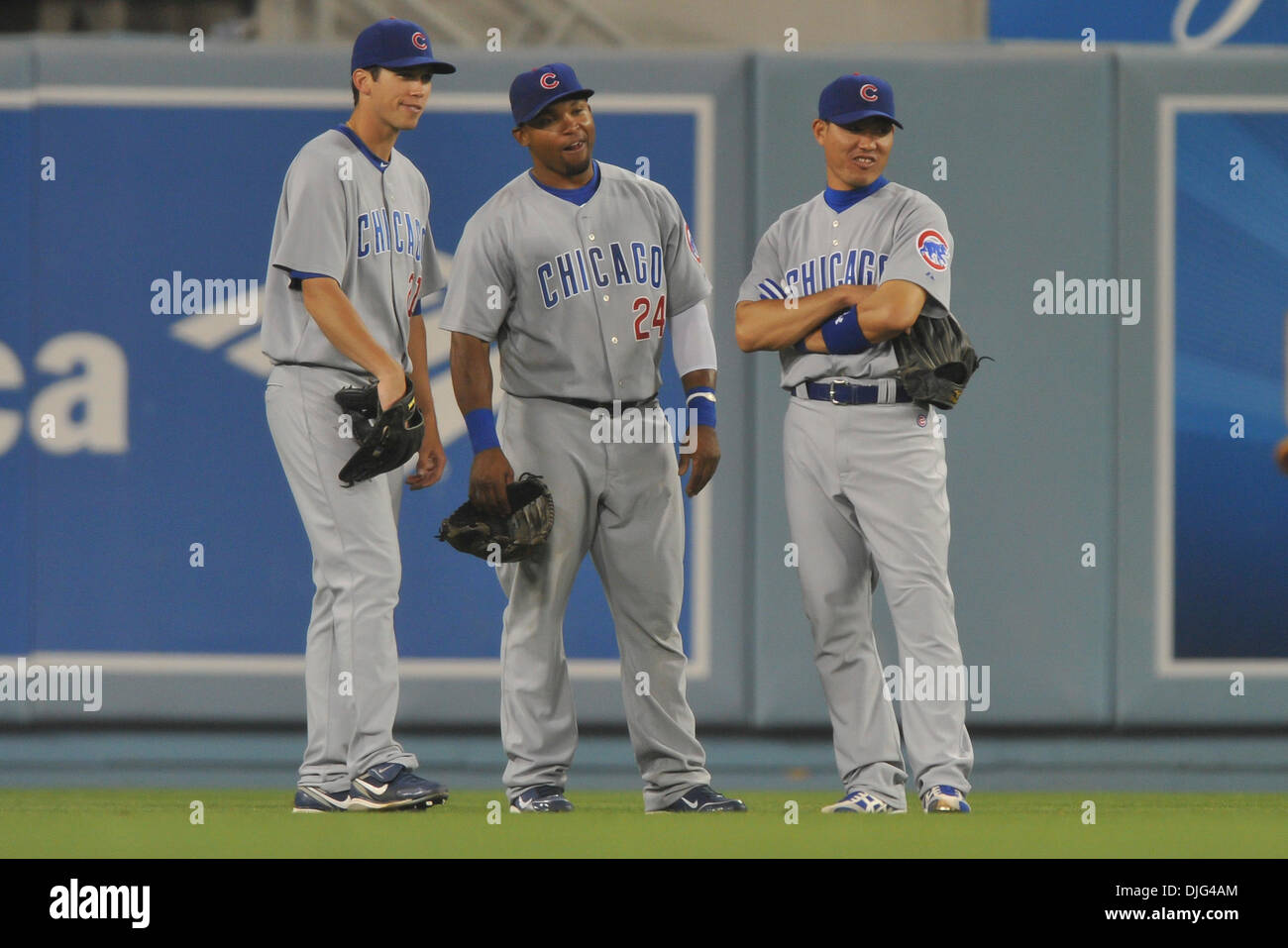 July 09, 2010 - Los Angeles, California, USA - 9 July 2010: Cubs outfielders from left, Tyler Colvin (21), Marlon Byrd (24), and Kosuke Fukodome (1) stand around during a pitching change .The Los Angeles Dodgers defeated the Chicago Cubs, 9-7,  at Dodger Stadium in Los Angeles, California. .Mandatory Credit: Andrew Fielding / Southcreek Global (Credit Image: © Andrew Fielding/South - Stock Image