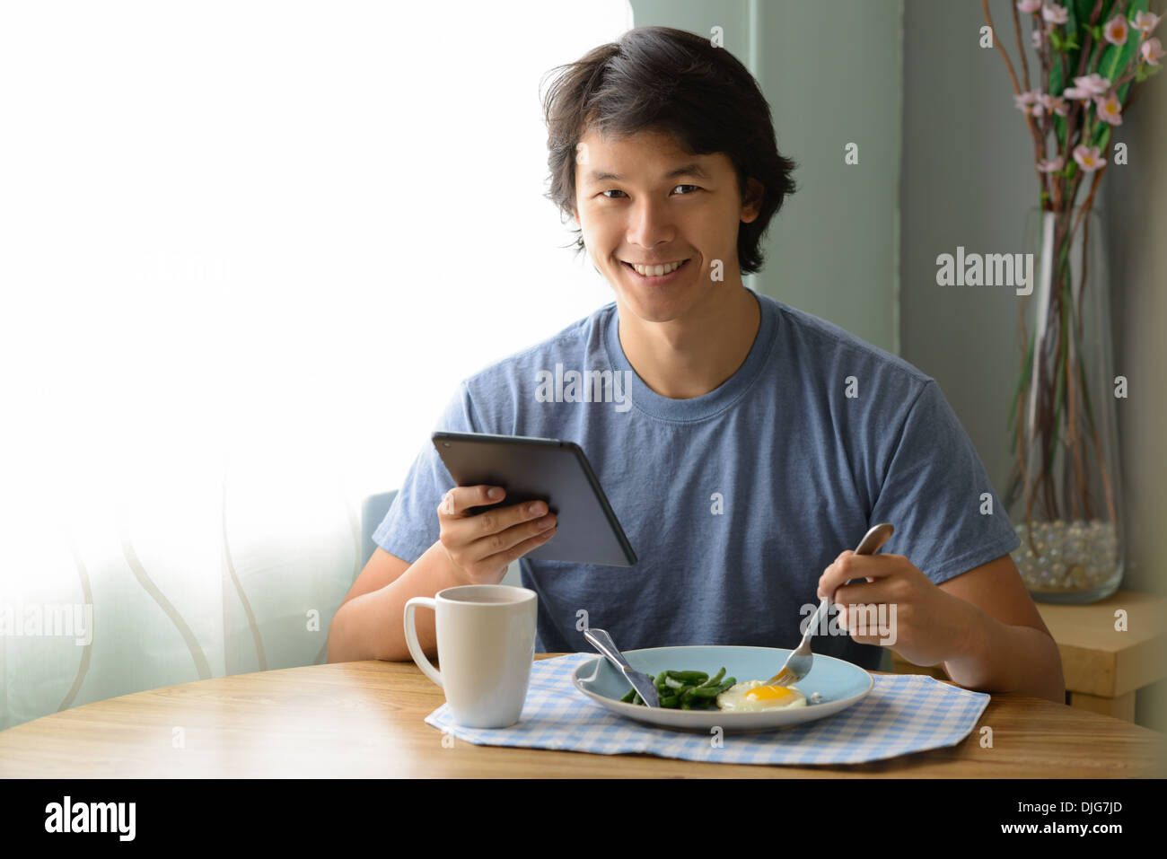 Asian man eating