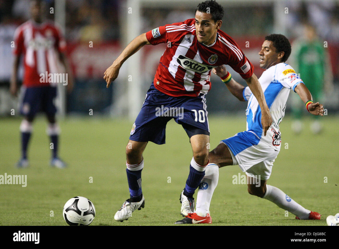 July 15, 2010 - Carson, California, United States of America - 15 July 2010: Chivas USA MF #10 Jesus Padilla (L) and Puebla FC MF #10 Andres Olivera (R) fight for the ball during the InterLiga match of Chivas USA vs Puebla FC at the Home Depot Center in Carson, California. Puebla FC went on to defeat Chivas USA with a final score of 2-1. Mandatory Credit: Brandon Parry / Southcreek - Stock Image