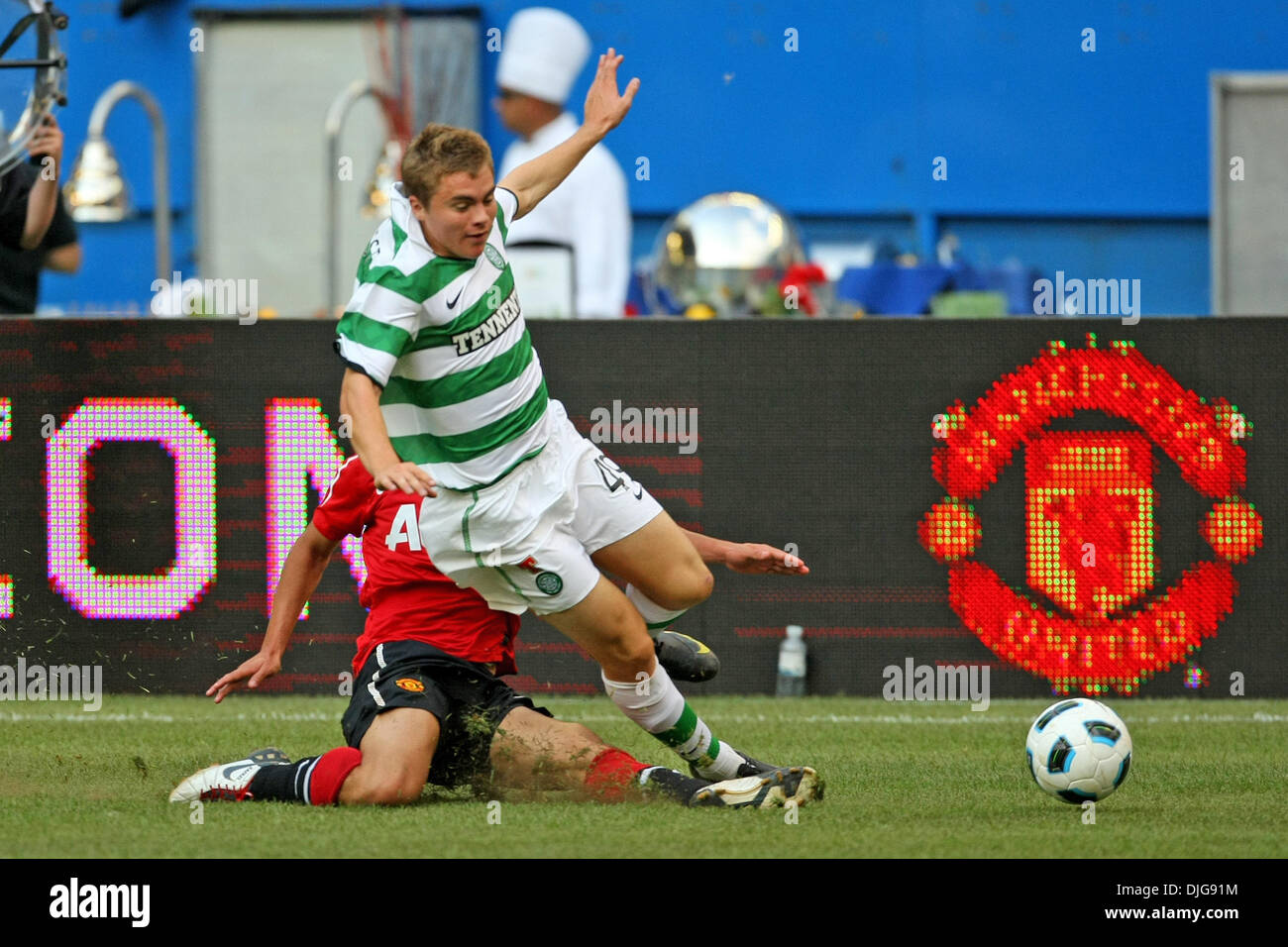 July 16, 2010 - Toronto, Ontario, Canada - 16 July 2010: Celtic FC James Forrest (49) is tripped up during a soccer game against  Manchester United at the Rogers Centre in Toronto, Ontario..Mandatory Credit: Anson Hung / Southcreek Global. (Credit Image: © Southcreek Global/ZUMApress.com) - Stock Image