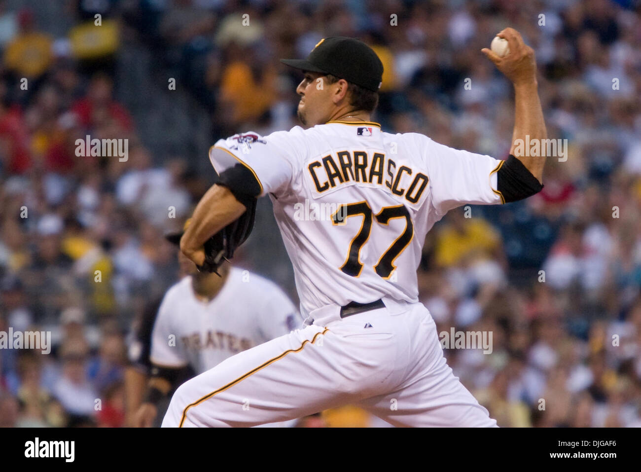 July 17, 2010 - Pittsburgh, Pennsylvania, United States of America - 17 July 2010: Pittsburgh Pirates relief pitcher D.J. Carrasco (77) fires a pitch to the plate during the National League game between the Houston Astros and the Pittsburgh Pirates.  The Pirates defeated the Astros 12-6 before 36,665 fans at PNC Park in Pittsburgh PA.  Mandatory Credit: Frank Jansky / Southcreek Gl - Stock Image
