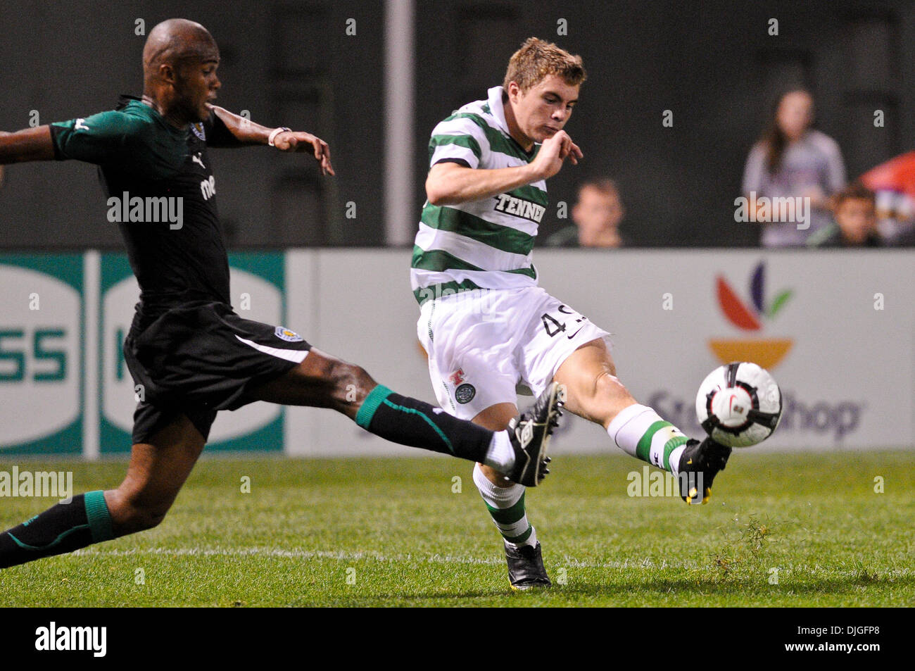 July 21, 2010 - Boston, Massachusetts, United States of America - 21 July 2010: Celtic midfielder James Forrest (49) kicks the ball towards the goal before being tackled by Sporting defender Evaldo (5). Celtic FC defeated Sporting 6 - 5 in penalty kicks, with a final 1 - 1 score during an international friendly at Fenway Park, Boston, Massachusetts to win the first Fenway Football  - Stock Image