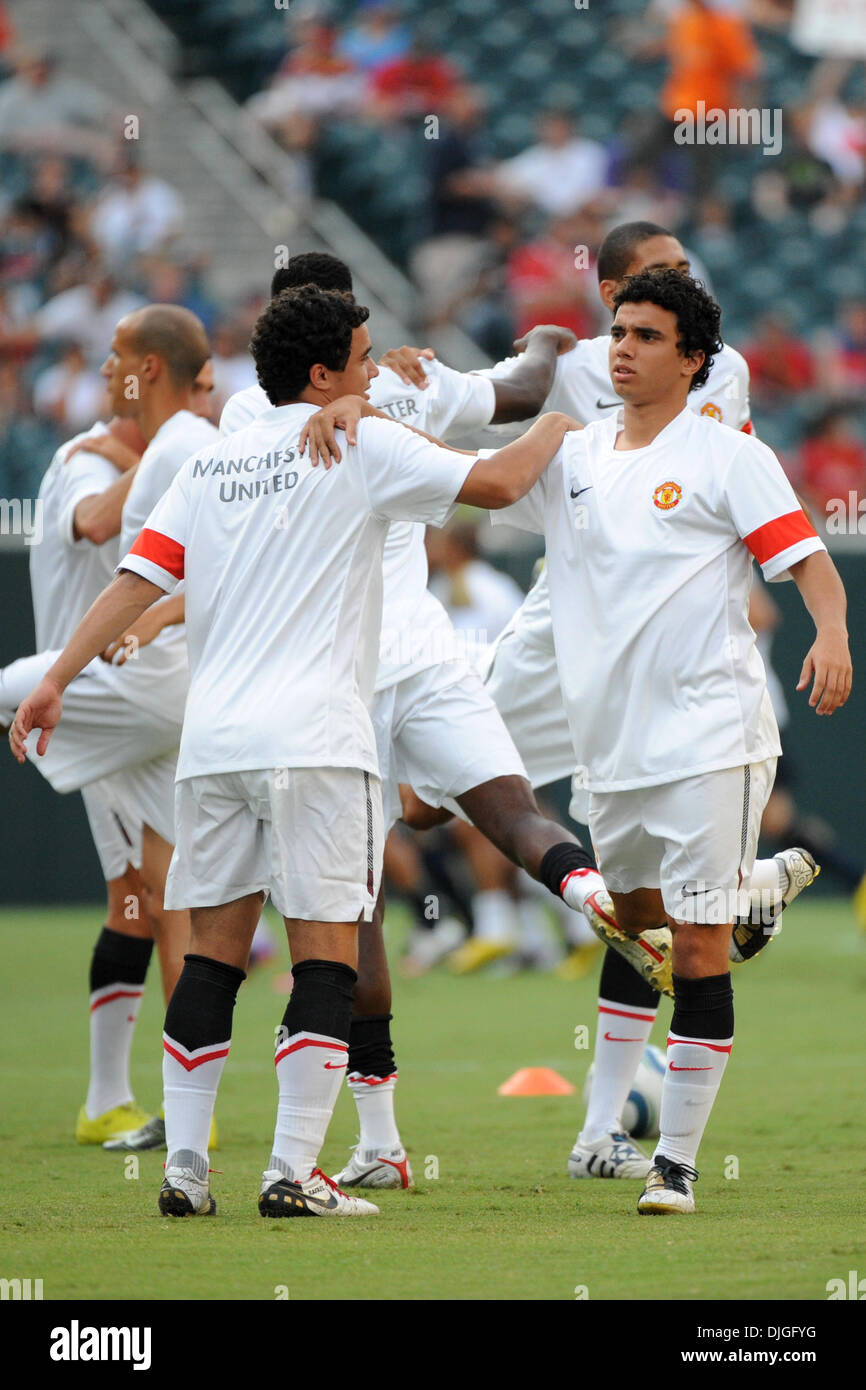 July 21, 2010 - Philadelphia, PA, United States of America - 21 July 2010 - Identical twins Manchester United Defenders Fabio DiSilva (#20) and Rafael DiSilva (#21) prior to the Eighteen times English Premier League Champion Summer 2010 tour, at Lincoln Financial Field in Philadelphia, PA. Mandatory credit: Brooks Von Arx, Jr./Southcreek Global (Credit Image: © Southcreek Global/ZU - Stock Image