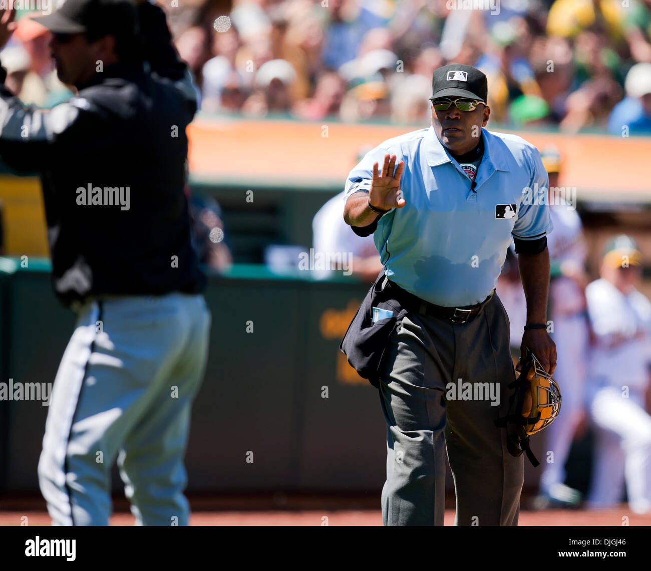 July 24, 2010 - Oakland, CA, United States of America - July 24, 2010: Home plate umpire Laz Diaz warns Sox Manager Ozzie Guillen to return to the dugout during the game between the Oakland A's and the Chicago White Sox at the Oakland-Alameda County Coliseum in Oakland CA. The A's defeated the White Sox 10-2. Mandatory Credit: Damon Tarver/ Southcreek Global. (Credit Image: © South - Stock Image