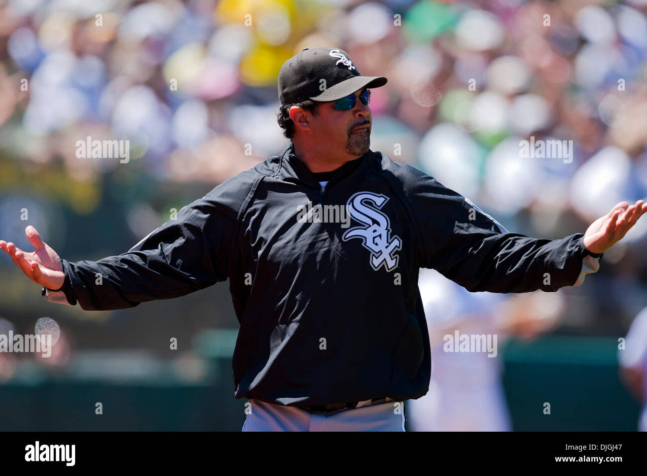 July 24, 2010 - Oakland, CA, United States of America - July 24, 2010: White Sox Manager Ozzie Guillen  complains to the umpire during the game between the Oakland A's and the Chicago White Sox at the Oakland-Alameda County Coliseum in Oakland CA. The A's defeated the White Sox 10-2. Mandatory Credit: Damon Tarver/ Southcreek Global. (Credit Image: © Southcreek Global/ZUMApress.com - Stock Image