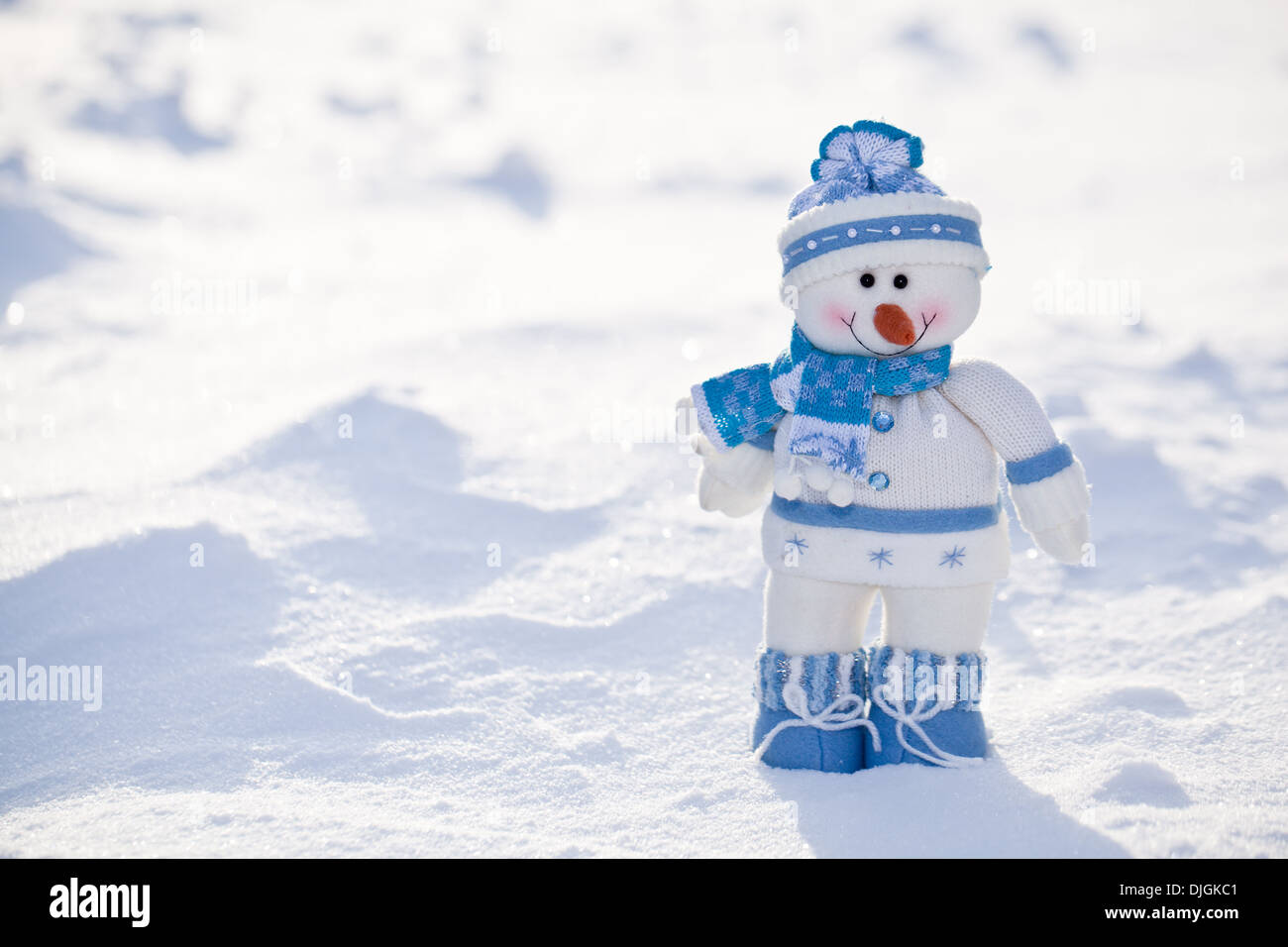 Little snowman with carrot nose in the snow. - Stock Image