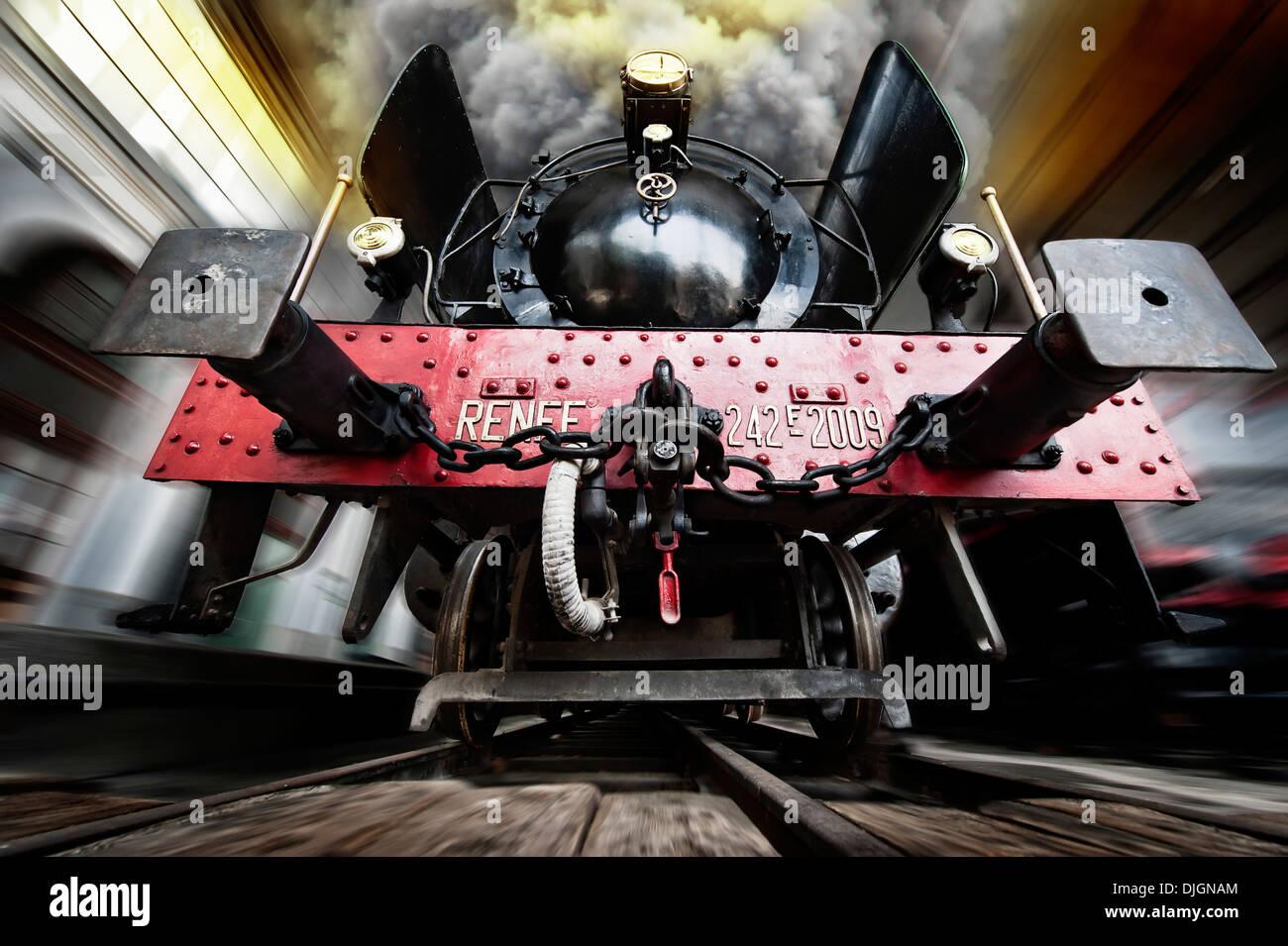 Steam locomotive train at full speed - Stock Image