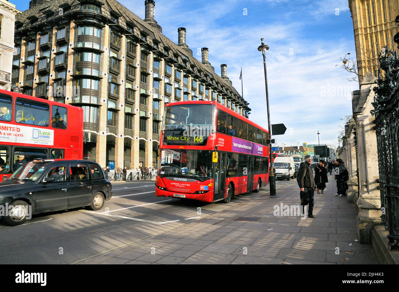 London bus passing Portcullis House and Westminster Underground Station, City of Westminster, London, England, UK - Stock Image