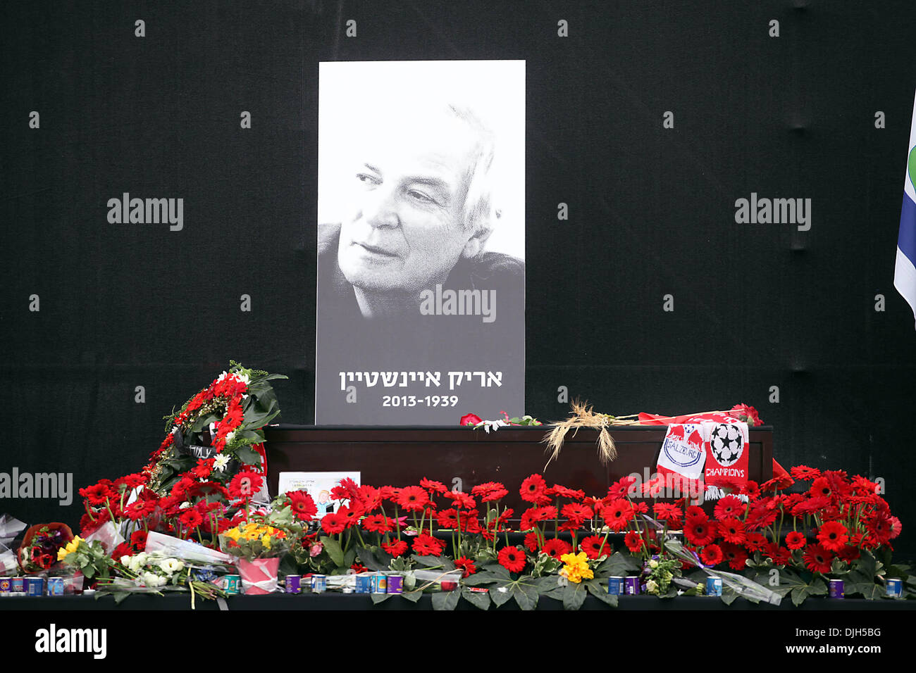 Tel Aviv, Israel. 28th Nov, 2013. A portrait photograph and the coffin of late Israeli singer and songwriter Arik Einstein are seen during a memorial ceremony before his funeral at Rabin's Square in Tel Aviv, Israel, Nov. 27, 2013. Arik Einstein died of a heart failure at the age of 74 on Nov. 26. Thousands of Israelis came to pay their last respects to the country's great cultural figure. (Xinhua/JINI)(lrz) Credit:  Xinhua/Alamy Live News - Stock Image