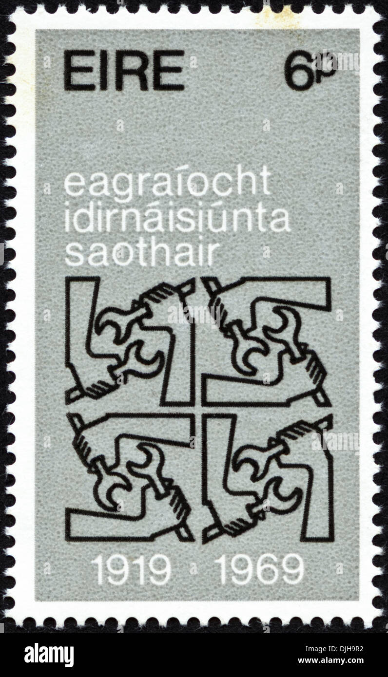 postage stamp Eire 9p featuring 50th Anniversary of International Labour Organisation 1919 - 1969 issued 1969 Gaelic - Stock Image