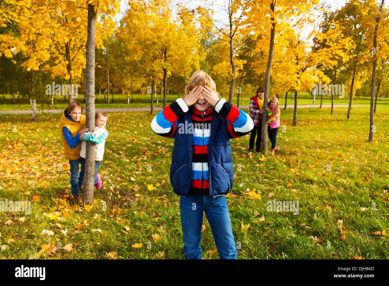 Hide Seek Kids: Group Of Five Kids Play Hide And Seek With Boy Counting