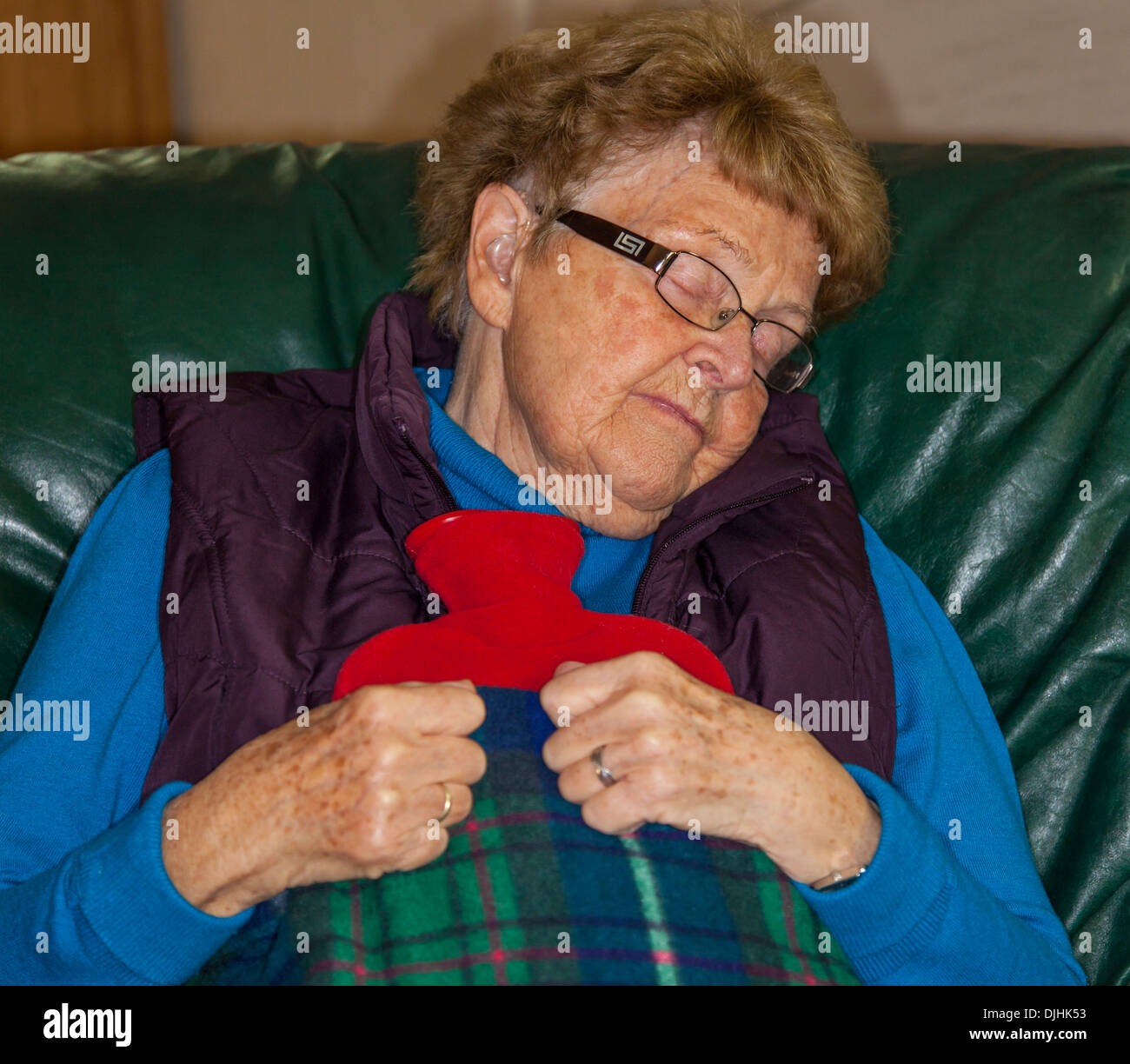 Pensioner feeling the extreme cold - Stock Image