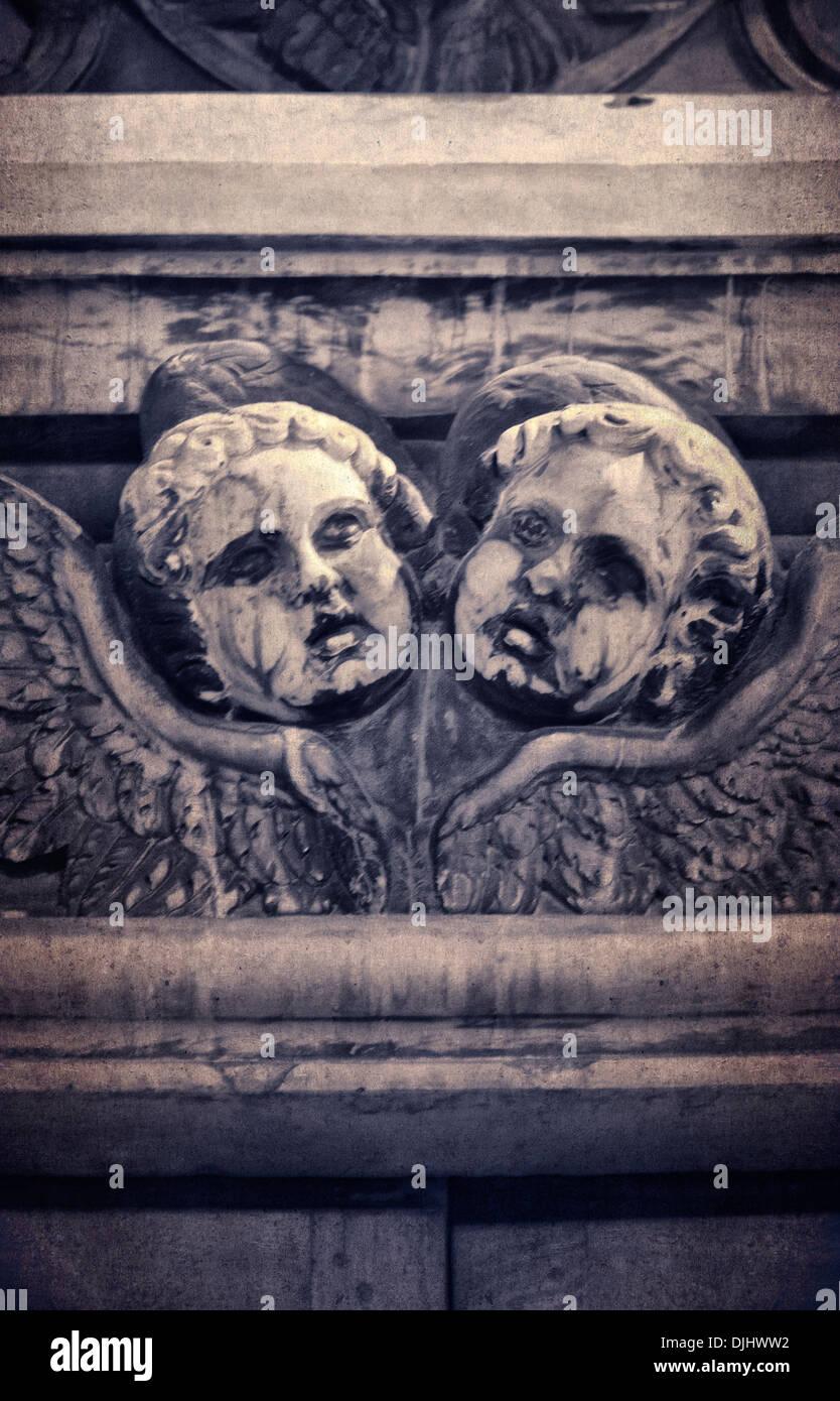 Two Carved Putti Architecture in Cagliari - Sardinia - Stock Image