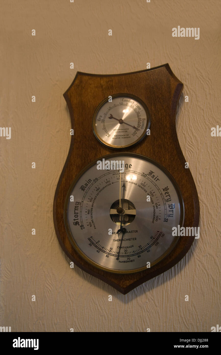 Close up Wooden weather station showing change pending high humidity and temperature - Stock Image