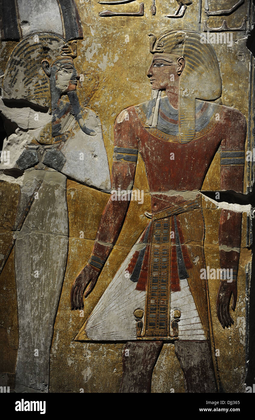 King Seti I in front of the God Osiris. Fragment of a pillar. Limestone. New Kingdom. 19th Dynasty. 1290 BC. Grave Stock Photo