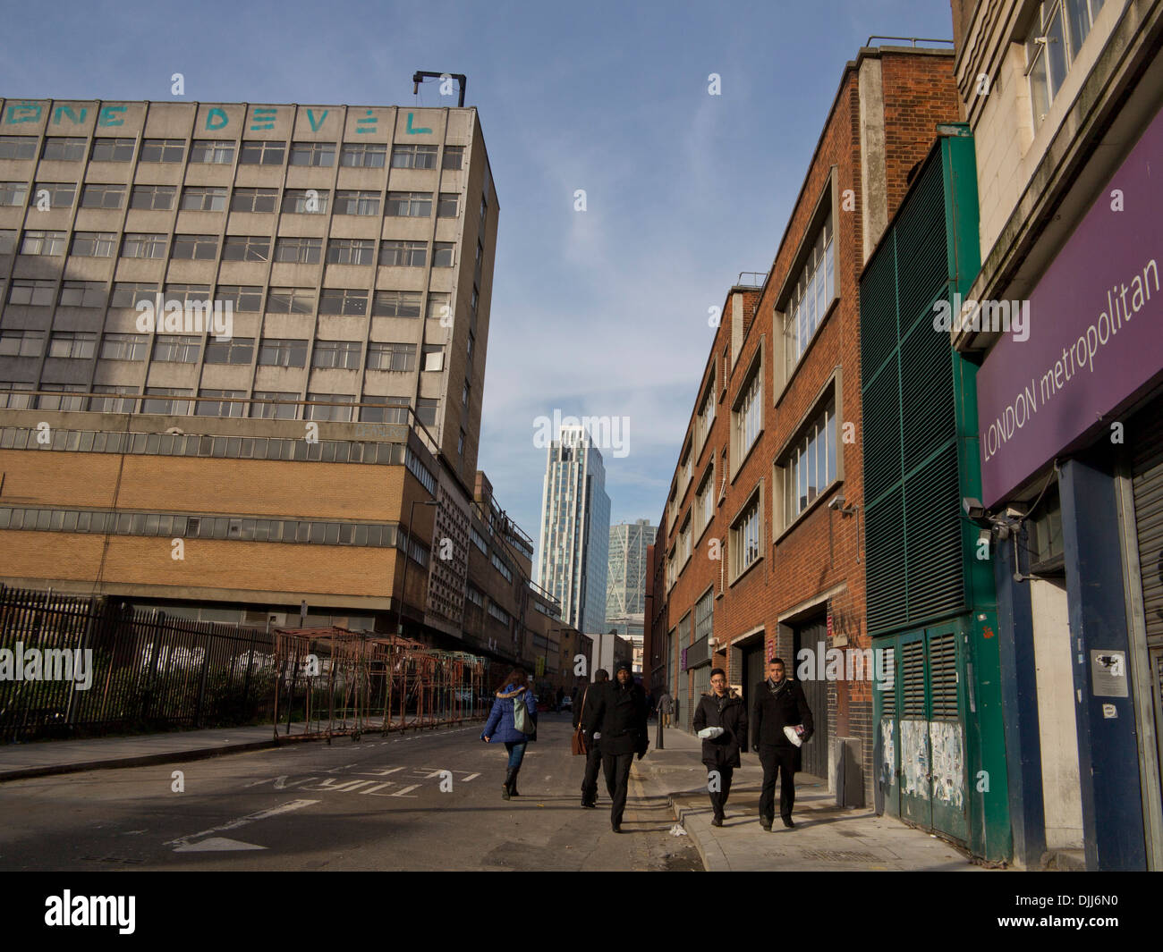 New construction work by old council housing in Aldsgate, London, UK - Stock Image