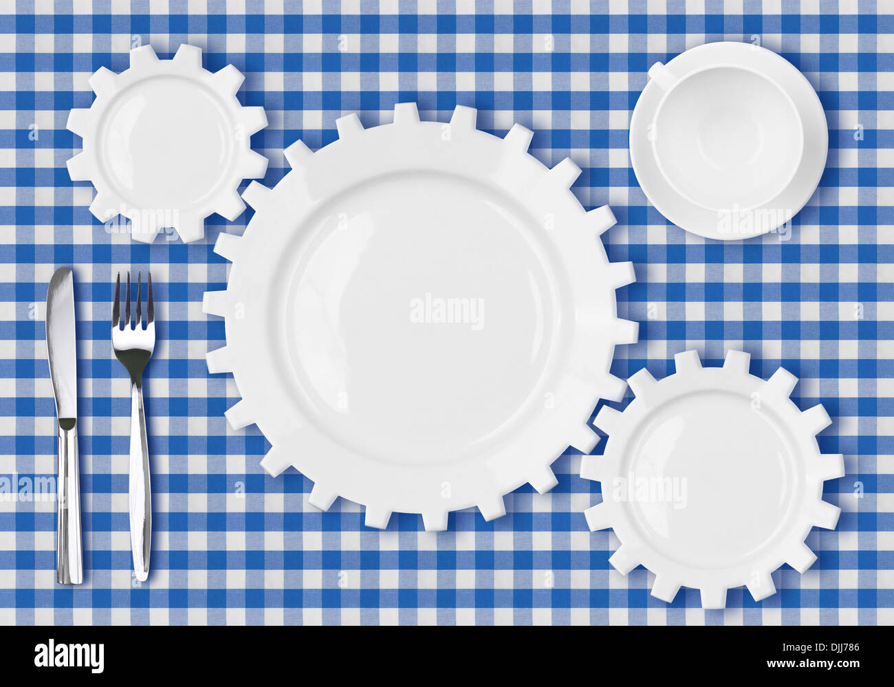 plates gears work concept. Dinner dishes over blue tablecloth. - Stock Image