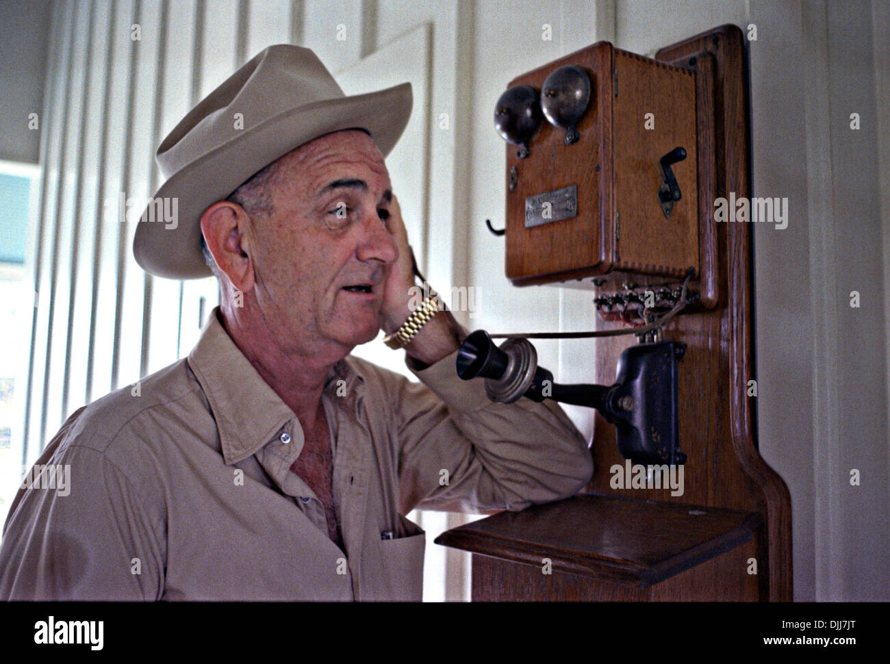US President Lyndon B. Johnson in a cowboy hat talking on an antique  telephone at 852c72c7775