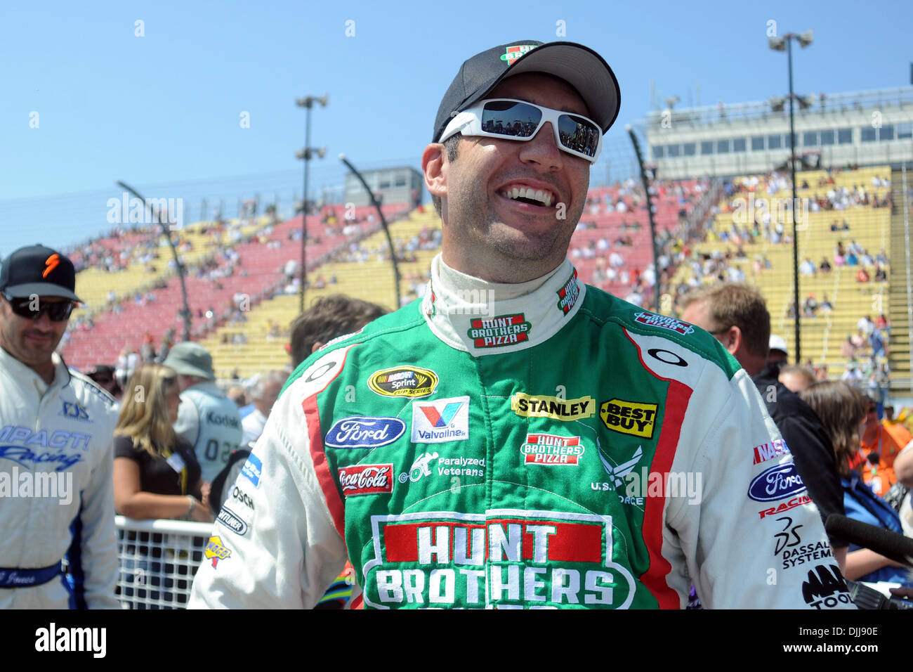 Aug. 08, 2010 - Watkins Glen, New York, United States of America - August 8, 2010: Petty Motorsports driver ELLIOTT SADLER smiles as he looks at other drivers on the stage before driver introductions for the Heluva Good! Sour Cream Dips at the Glen Sprint Cup race at Watkins Glen International, Watkins Glen, NY..Mandatory Credit: Michael Johnson / Southcreek Global (Credit Image: © - Stock Image