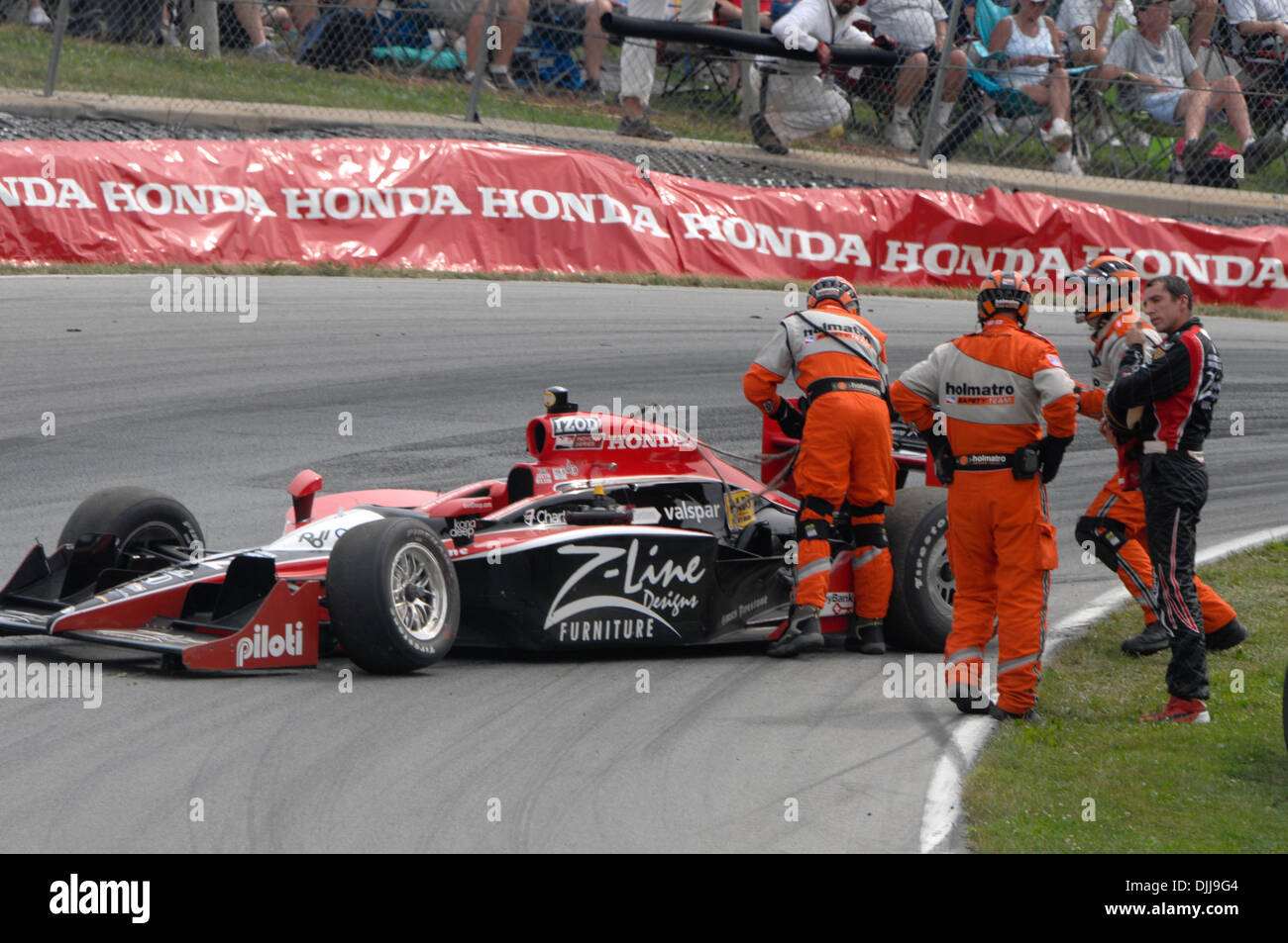 Aug. 08, 2010 - Lexington, Ohio, United States of America - 8 August, 2010; Dreyer & Reinbold Racing's JUSTIN WILSON speaks with a member of the Holmatro safety team after Wilson's crash during the Izod IndyCar Series Honda Indy 200 at the Mid-Ohio Sports Car Course in Lexington, Ohio..Mandatory Credit: Will Schneekloth / Southcreek Global (Credit Image: © Southcreek Global/ZUMApre - Stock Image