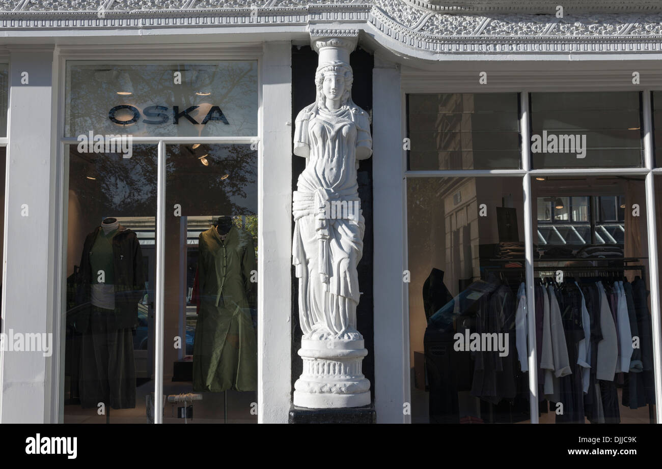 An ornate caryatid at Montpellier Walk Cheltenham UK, a scuplture in the female form used as an architectural support - Stock Image