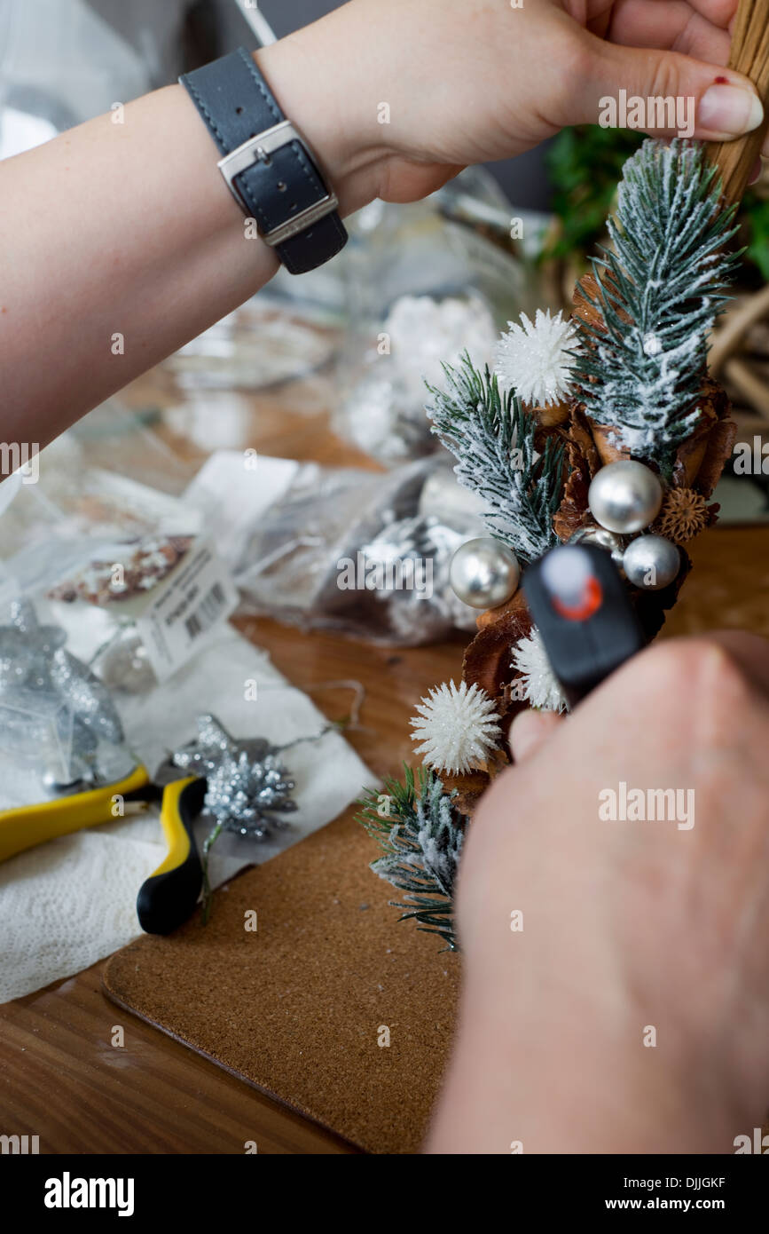 Close-up of a woman making home-made Christmas decorations Stock Photo