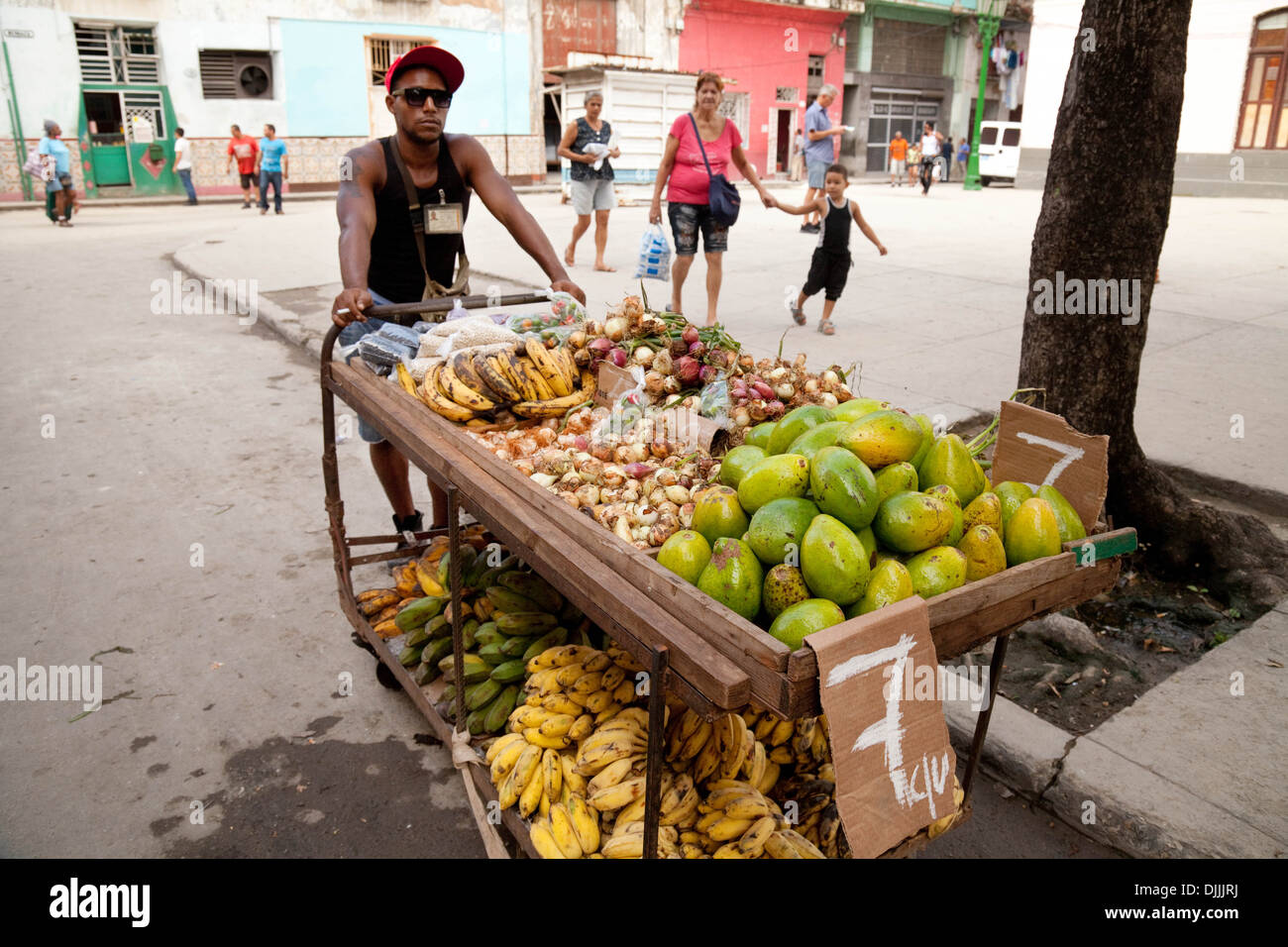 A stallkeeper and his fruit stall, Brasil St, Havana, Cuba, Caribbean - Stock Image