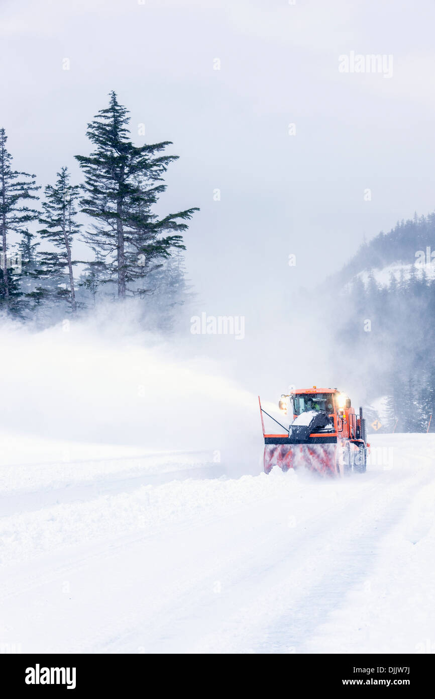 City Of Whittier Snow Removal Crew Plowing The Road To Shotgun Cove After A Snow Storm, Winter Whittier, Southcentral Alaska - Stock Image