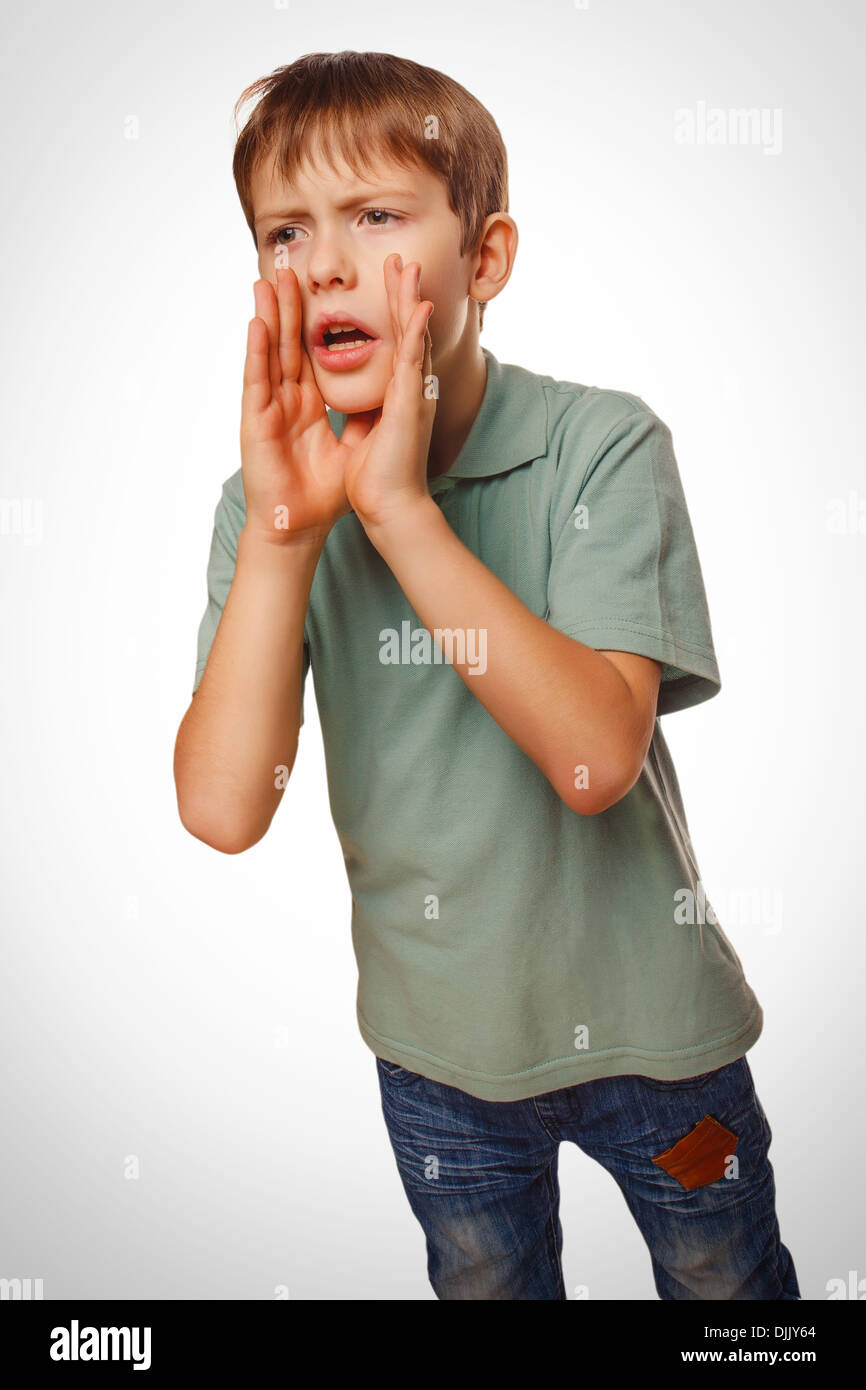 boy cries teenager calling opened his mouth emotion - Stock Image