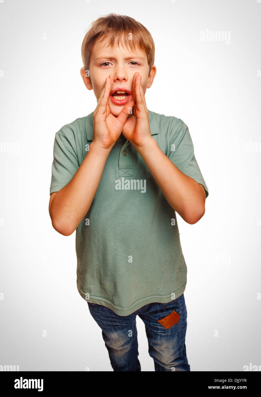 teenager boy cries calling opened his mouth emotion - Stock Image