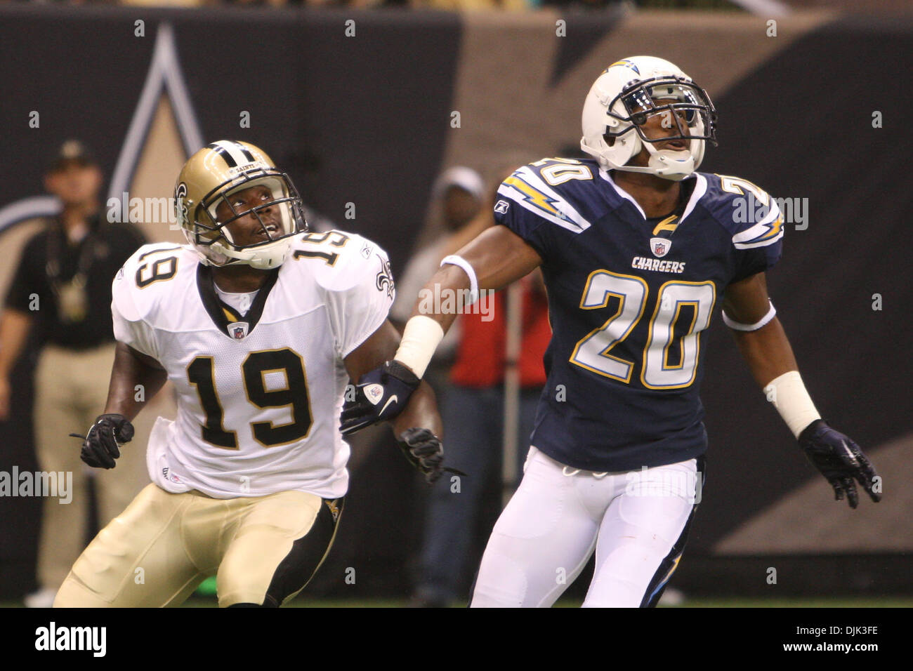 Aug 21, 2010: New Orleans Saints wide receiver Devery Henderson (19) and San Diego Chargers cornerback Antoine Cason Stock Photo