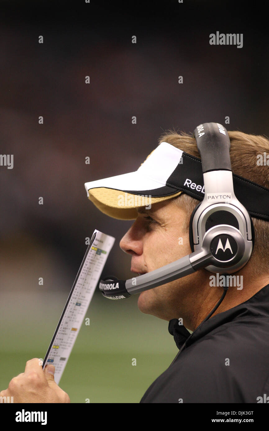 Aug 21, 2010: New Orleans Saints head coach Sean Payton calls in a play during the preseason game between the New Stock Photo