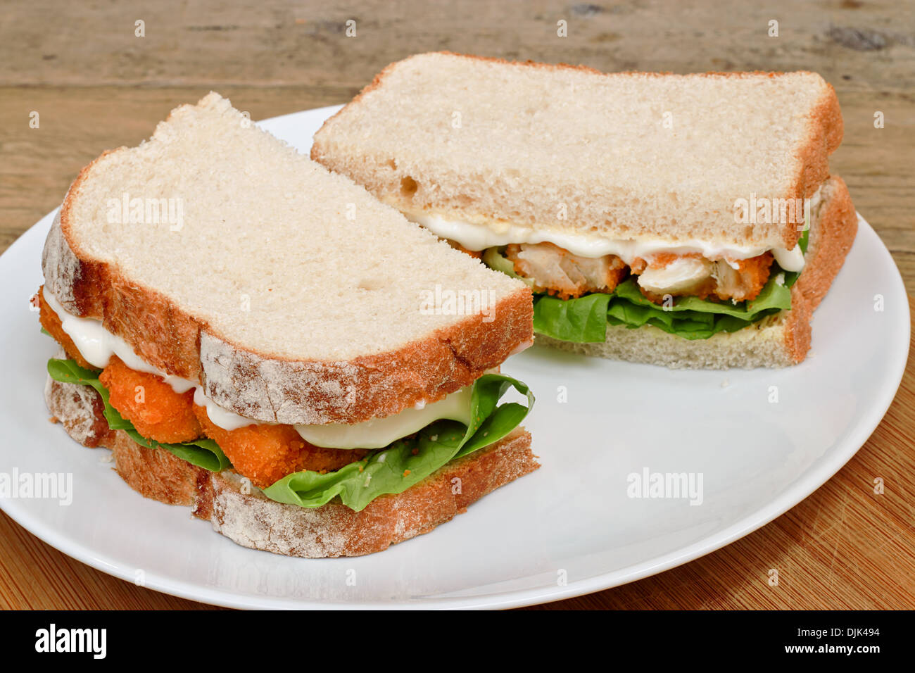 Fresh Fish Finger Sandwich on a white serving plate - Stock Image