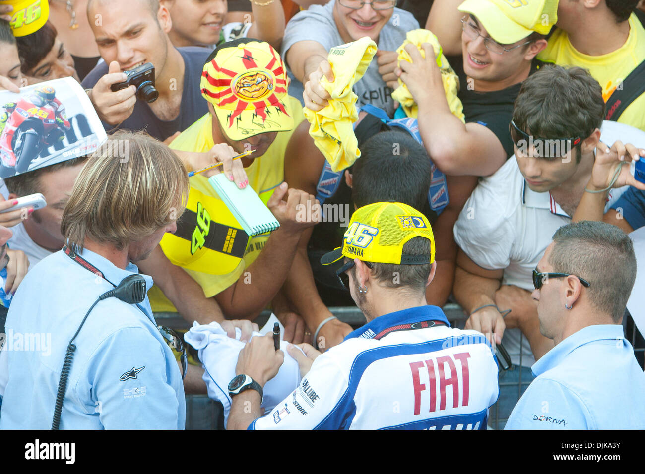 Sep. 03, 2010 - Misano Adriatico, Italy - Yamaha rider Valentino Rossi (#46) signing a utograph to a huge crowd of fans during the pit walk on friday at the San Marino GP in Misano Adriatico, Italy. (Credit Image: © Andrea Ranalli/Southcreek Global/ZUMApress.com) - Stock Image