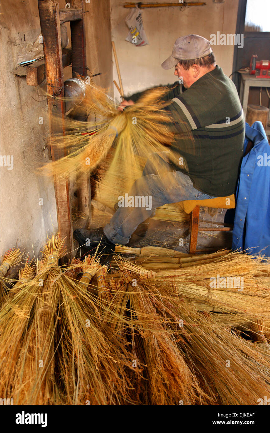 Mr Kostas Zarifis, one of the last traditional broom makers in his workshop, at Nea Vyssa, Evros, Thraki, Greece. - Stock Image